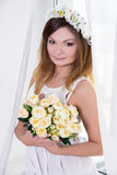 Portrait of beautiful bride in white dress with flowers near the Royalty Free Stock Photos