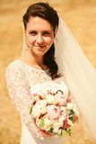 Portrait of beautiful bride on yellow field Stock Photo