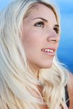Portrait of a beautiful bright girl. Against the sky Royalty Free Stock Images