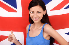 Portrait of a beautiful British girl smiling and signing thumbs up. Stock Photo