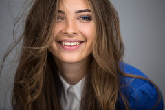 Portrait of a beautiful brown-haired girl Stock Image