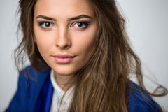 Portrait of a beautiful brown-haired girl Stock Photos