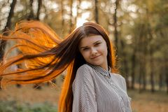 Portrait of a beautiful brown-haired young girl royalty free stock photo
