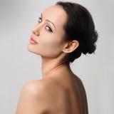 Portrait of beautiful brunet women. Portrait of beautiful brunet woman with nudeshoulders Stock Images