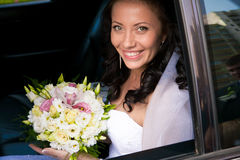 Portrait of beautiful brunette bride seating on ba Stock Photos