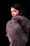 Portrait of a beautiful brunette with coat. Portrait of a attractive brunette wearing luxurious coat Stock Photo