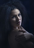 Portrait of a beautiful brunette with curly hair stock photography