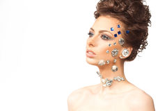 Portrait of beautiful brunette with diamonds on her face Royalty Free Stock Photo
