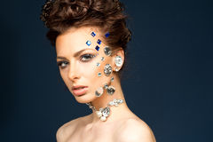 Portrait of beautiful brunette with diamonds on her face Stock Photography