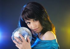 Portrait of beautiful brunette with disco ball Royalty Free Stock Images