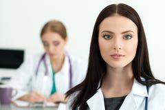 Portrait of beautiful brunette female medicine doctor Stock Images