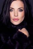 Portrait of a beautiful brunette in fur Stock Photo