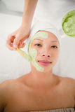 Portrait of a beautiful brunette getting a facial treatment Royalty Free Stock Images