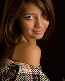 Portrait of beautiful brunette girl. Young teenage girl looking at camera Royalty Free Stock Photo
