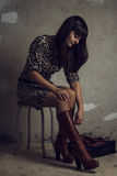 Portrait of beautiful brunette girl on grungy Stock Photography