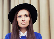 Portrait of beautiful brunette girl in hat looking at the camera Royalty Free Stock Image