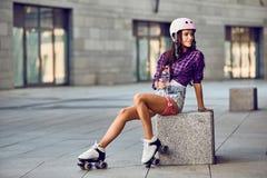 Portrait of beautiful brunette girl in helmet in urban skate park Stock Images