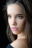 Portrait of the beautiful brunette girl isolated on black background Stock Images
