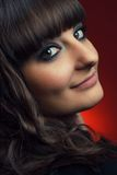 Beautiful brunette girl over red background Royalty Free Stock Photography