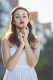 Portrait of a beautiful brunette girl in a short dress. With bright makeup Stock Photos