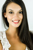 Portrait of a beautiful brunette girl smiling. Royalty Free Stock Image