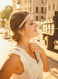 Portrait of beautiful brunette girl on street at sunny day Royalty Free Stock Photo