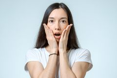 Portrait of a beautiful brunette girl with a surprised look Stock Image