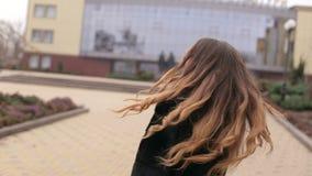 Portrait of beautiful brunette girl walking down the street. stock footage