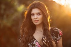 Portrait of a beautiful brunette girl with wavy. royalty free stock photos