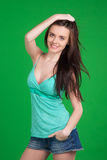 Portrait of beautiful brunette girl over green background Royalty Free Stock Photo