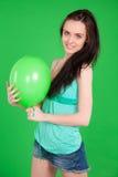 Portrait of beautiful happy brunette girl  wearing shorts holdin Royalty Free Stock Photos