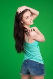 Portrait of beautiful brunette girl  wearing shorts Royalty Free Stock Image