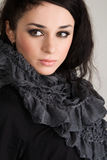 Portrait of a beautiful brunette in a gray scarf Stock Photos