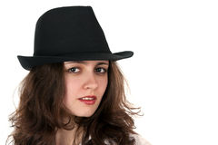 Portrait of a beautiful brunette in a hat Royalty Free Stock Photography