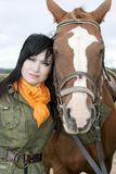 Portrait of beautiful brunette with horse Royalty Free Stock Image