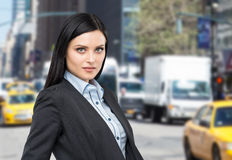 Portrait of a beautiful brunette lady in a formal suit. New York street background Stock Photography