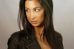 Portrait of a beautiful brunette with a leather jacket Stock Photography