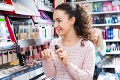 Portrait of beautiful brunette selecting foundation stock photo