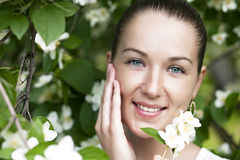 Portrait of beautiful brunette in spring blossom Stock Photos