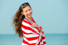 Portrait of a beautiful brunette with a towel Stock Image