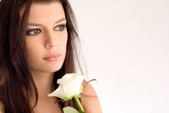 Portrait of beautiful brunette with white rose. Royalty Free Stock Photos