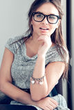 Portrait of beautiful brunette woman. In glasses Royalty Free Stock Photos