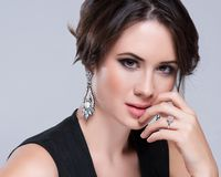 Portrait of beautiful brunette woman in black dress. Cosmetic Eyeshadows. Stock Images