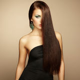 Portrait of beautiful brunette woman in black dress Stock Photography