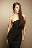 Portrait of beautiful brunette woman in black dress Stock Images