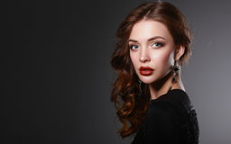 Portrait of beautiful brunette woman in black Royalty Free Stock Images