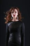 Portrait of beautiful brunette woman in black Stock Photos