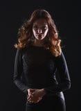Portrait of beautiful brunette woman in black Stock Photography