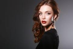 Portrait of beautiful brunette woman in black Royalty Free Stock Image