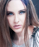 Portrait of  beautiful brunette woman with blue eyes. Royalty Free Stock Image